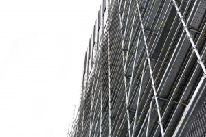 Low angle vie of scaffolding, white background with copy space, full frame horizontal composition
