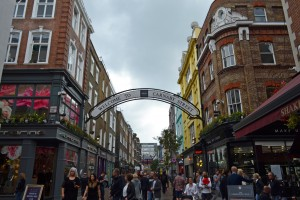 London, UK - September 13, 2014: view down Carnaby Street with shoppers in London, UK. It is an iconic fashion street in the Soho district famous in the 1960s for mods and hippies.