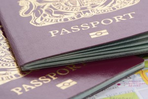London, United Kingdom - December 12, 2013: A Close Up Shot Of Two United Kingdom Biometric Passports On A Road Map Taken In A Studio